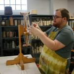 Trey demonstrating winding a skein