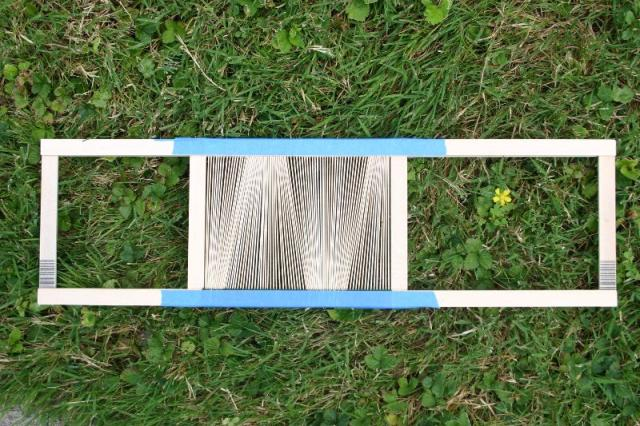 reed with tape to secure spacer yarn