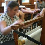 Amy demonstrating winding a warp onto the loom